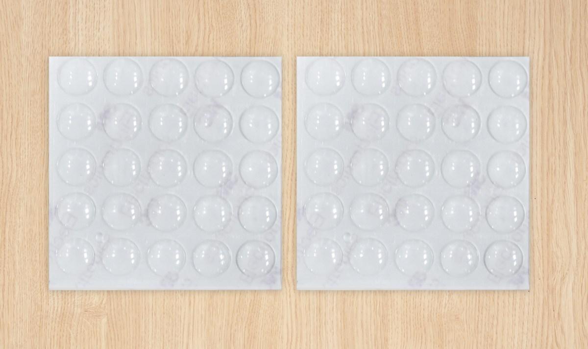 50 szt. Podk³adki samoprzylepne, amortyzatory uderzeñ drzwi i szuflad ¶rednica 1 cm